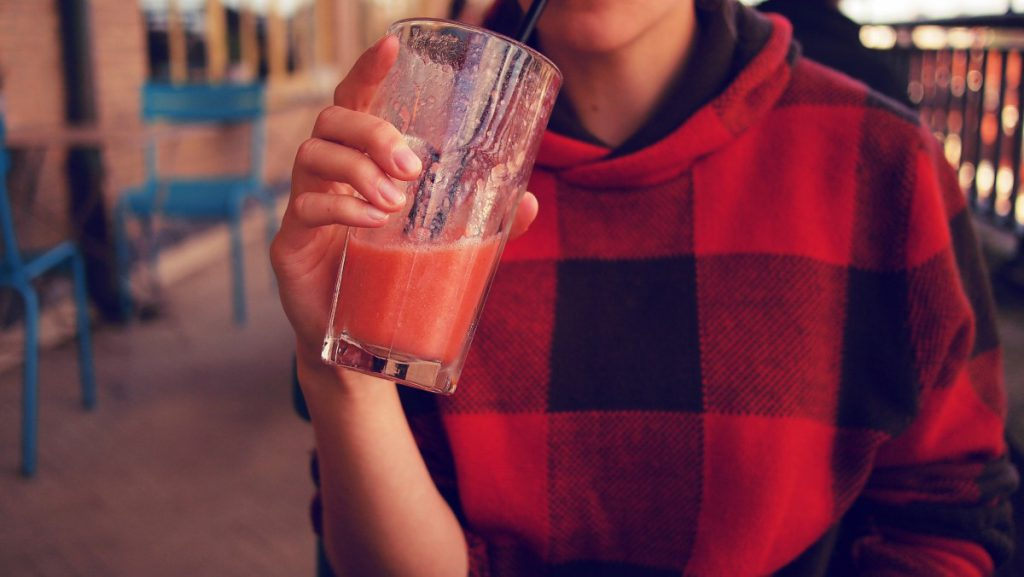 Girl drinking berry smoothie
